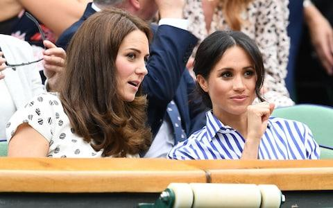 Catherine, Duchess of Cambridge and Meghan, Duchess of Sussex at Wimbledon - Credit: Clive Mason/Getty Images