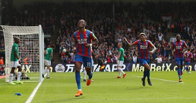 "Soccer Football - Premier League - Crystal Palace vs West Bromwich Albion - Selhurst Park, London, Britain - May 13, 2018 Crystal Palace's Wilfried Zaha celebrates scoring their first goal REUTERS/Hannah McKay EDITORIAL USE ONLY. No use with unauthorized audio, video, data, fixture lists, club/league logos or ""live"" services. Online in-match use limited to 75 images, no video emulation. No use in betting, games or single club/league/player publications. Please contact your account representative for further details."