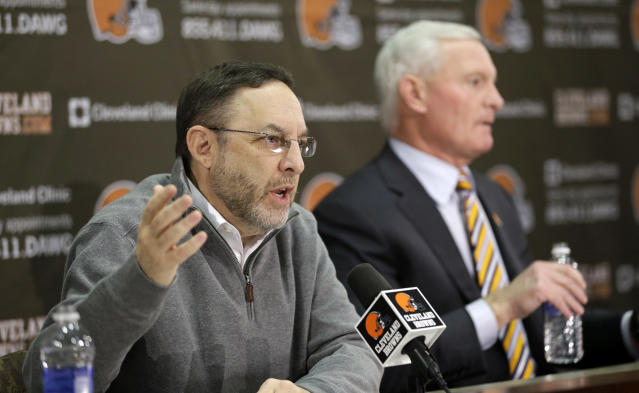 Cleveland Browns CEO Joe Banner answers questions during a news conference at the Browns' training facility Monday, Dec. 30, 2013, in Berea, Ohio. Owner Jimmy Haslam, right, listens. Head coach Rob Chudzinski was fired Sunday. (AP Photo/Tony Dejak)