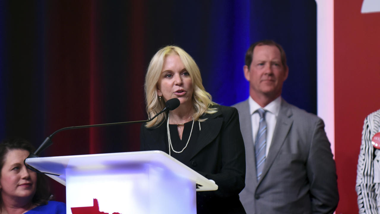 In a Friday, June 1, 2018 photo, Minnesota state Sen. Karin Housley, R-St. Mary's Point, speaks to delegates at the Republican Party of Minnesota convention as her husband, NHL Hall of Famer Phil Housley, looks on in the Duluth, Minn., convention center. (Dave Orrick/Pioneer Press via AP)