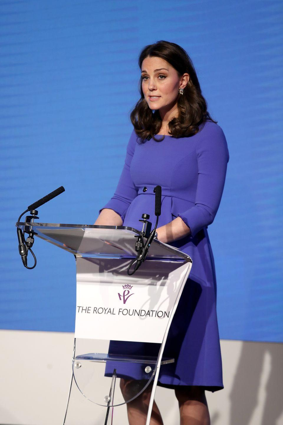 """<p>Duchess Kate wore a button-detailed blue dress by Seraphine with a pair of navy heels <a href=""""https://www.townandcountrymag.com/society/tradition/a18921806/meghan-markle-comments-me-too-times-up/"""" rel=""""nofollow noopener"""" target=""""_blank"""" data-ylk=""""slk:at the Royal Foundation Forum,"""" class=""""link rapid-noclick-resp"""">at the Royal Foundation Forum,</a> where she appeared with Meghan Markle, Prince Harry, and Prince William. </p>"""