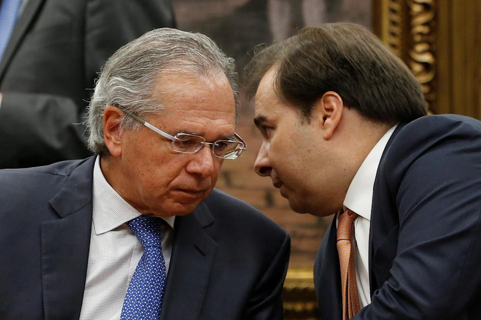 Brazil's Economy Minister Paulo Guedes speak with President of the Chamber of Deputies Rodrigo Maia during a meeting of the committees of the Constitution, Justice and Citizenship (CCJ) in Brasilia, Brazil April 3, 2019. REUTERS/Adriano Machado