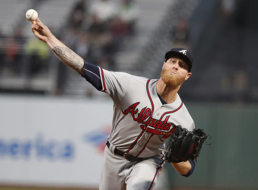 Atlanta Braves starting pitcher Mike Foltynewicz (26) throws against the San Francisco Giants during the first inning of a baseball game in San Francisco, Tuesday, Sept. 11, 2018. (AP Photo/Tony Avelar)