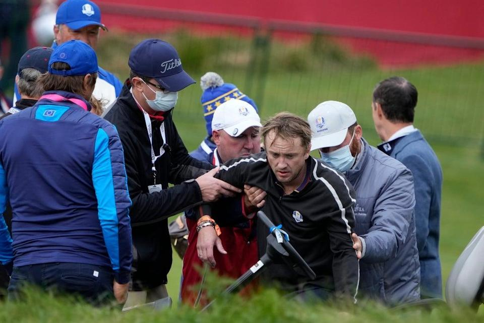 Tom Felton is helped after collapsing on the Ryder Cup course  (AP)