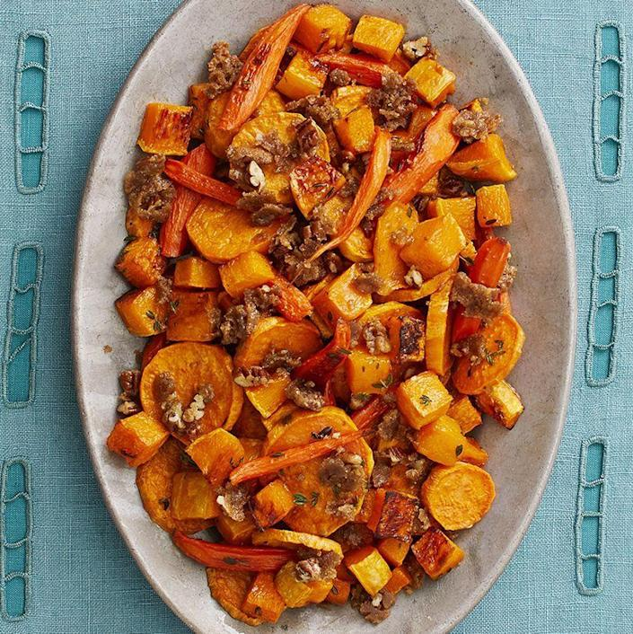 """<p>A sweet and smoky crumble topping makes these roasted root vegetables like nothing you've ever tasted. </p><p><a href=""""https://www.thepioneerwoman.com/food-cooking/recipes/a33251632/roasted-vegetables-with-pecan-crumble-recipe/"""" rel=""""nofollow noopener"""" target=""""_blank"""" data-ylk=""""slk:Get Ree's recipe."""" class=""""link rapid-noclick-resp""""><strong>Get Ree's recipe.</strong></a></p>"""