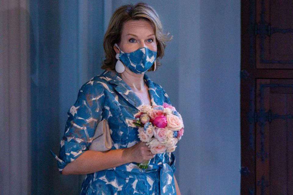<p>Belgium's Queen Mathilde has quickly become a pro at matching her mask to her outfit. Here, she sports a blue pattern during a visit to the Gruuthusemuseum.</p>