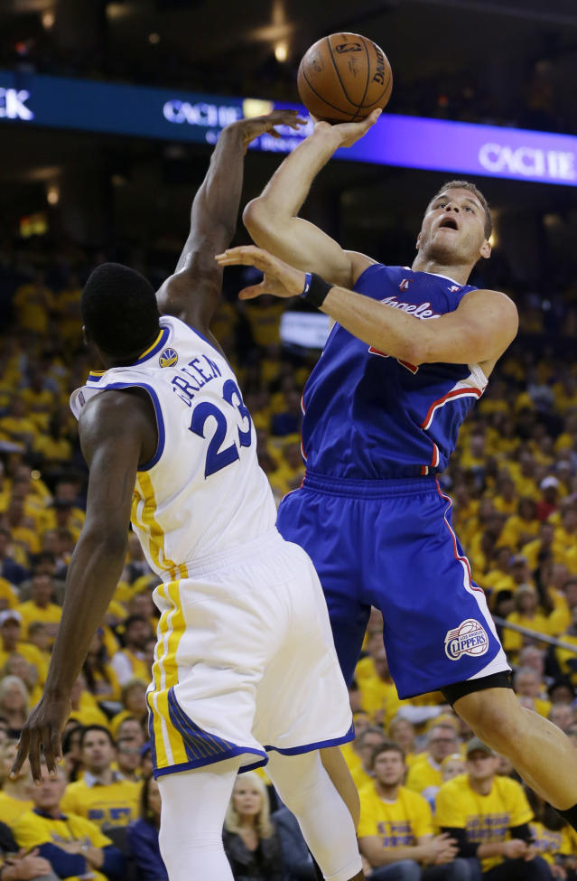 Los Angeles Clippers' Blake Griffin, right, goes up for a shot next to Golden State Warriors' Draymond Green during the first half in Game 4 of an opening-round NBA basketball playoff series on Sunday, April 27, 2014, in Oakland, Calif. (AP Photo/Marcio Jose Sanchez)