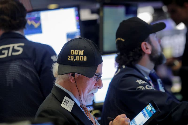 Trader Peter Tuchman wears a DOW 29,000 hat on the floor at the NYSE in New York