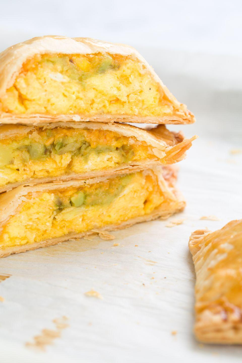 "<p>Stuffed with scrambled eggs, mashed avocado, and cheese, these are better than anything you'll find in the freezer aisle, and perfect for eating in bed.</p><p>Get the recipe from <a href=""https://www.delish.com/cooking/recipe-ideas/recipes/a44098/egg-avocado-and-cheddar-homemade-hot-pockets-recipe/"" rel=""nofollow noopener"" target=""_blank"" data-ylk=""slk:Delish"" class=""link rapid-noclick-resp"">Delish</a>.</p>"