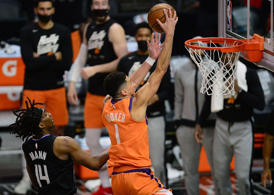 Devin Booker i2 averaging 27 points per game in his first postseason.