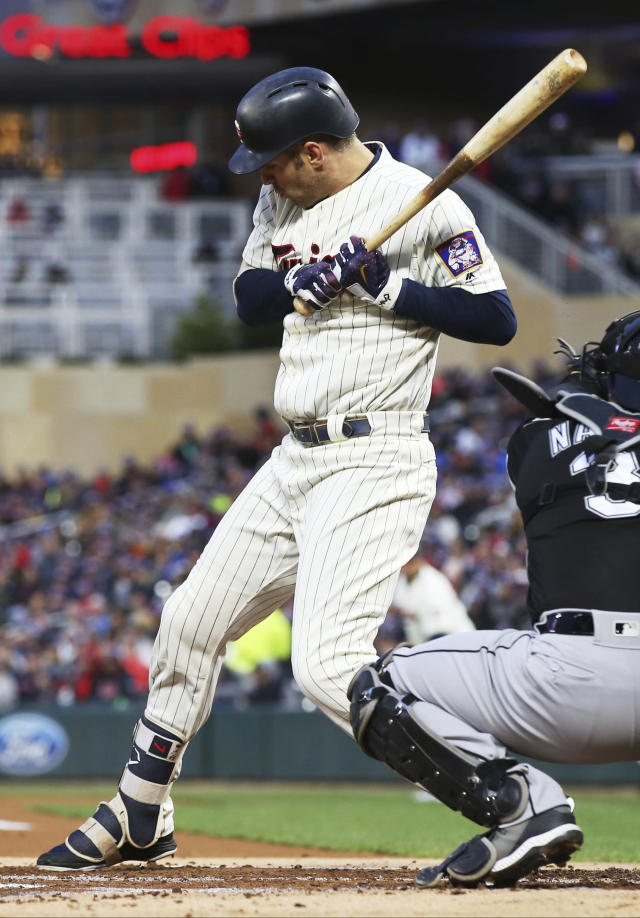 Minnesota Twins' Joe Mauer rears back to avoid a close pitch by Chicago White Sox pitcher Carlos Rodon and draws a walk in the first inning of a baseball game Saturday, Sept. 29, 2018, in Minneapolis. (AP Photo/Jim Mone)