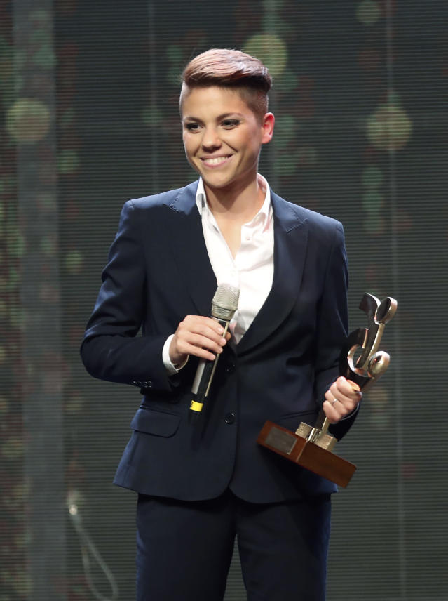 Manuela Giuliano poses with the trophy for best Italian Serie A women player, during the Gran Gala' soccer awards ceremony, in Milan, Italy, Monday, Dec. 2, 2019. (AP Photo/Antonio Calanni)