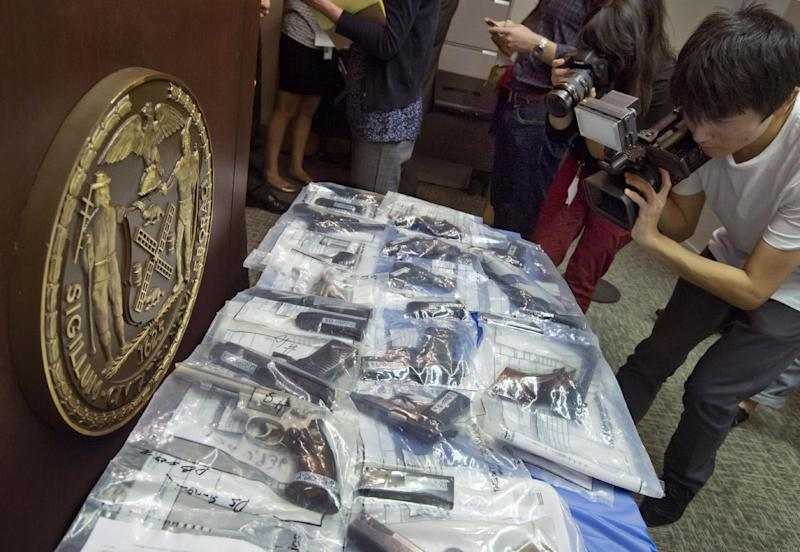 Guns seized during arrest of members of the Bonanno crime family are displayed at a news conference, Tuesday, July 9, 2013. Nine people have been indicted on enterprise corruption charges. (AP PhotoRichard Drew)