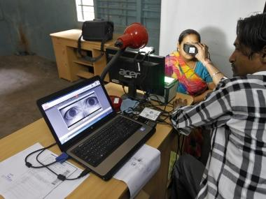 A woman goes through the process of eye scanning for Unique Identification (UID) database system. Reuters