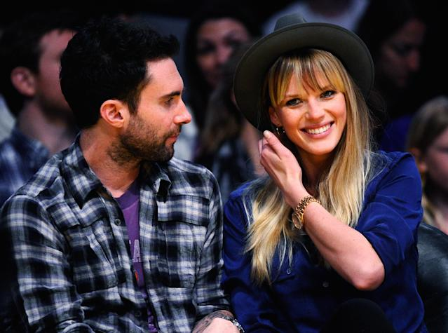 <p>Anne V and Adam Levine attend the Denver Nuggets and Los Angeles Lakers basketball game in 2011. </p>