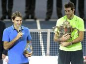 Switzerland's Roger Federer, left, congratulates the winner Argentina's Juan Martin del Potro, right, after the final match at the Swiss Indoors tennis tournament at the St. Jakobshalle in Basel, Switzerland, on Sunday, Oct. 28, 2012. (AP Photo/Keystone//Georgios Kefalas)