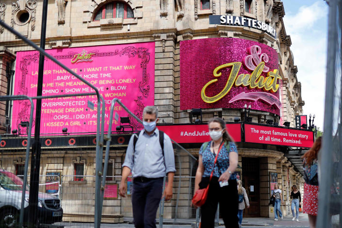 Image: Pedestrians walk past the Shaftesbury Theatre, which remains closed due to restrictions to slow the spread of the novel coronavirusm, in London's West End (Tolga Akmen / AFP - Getty Images)