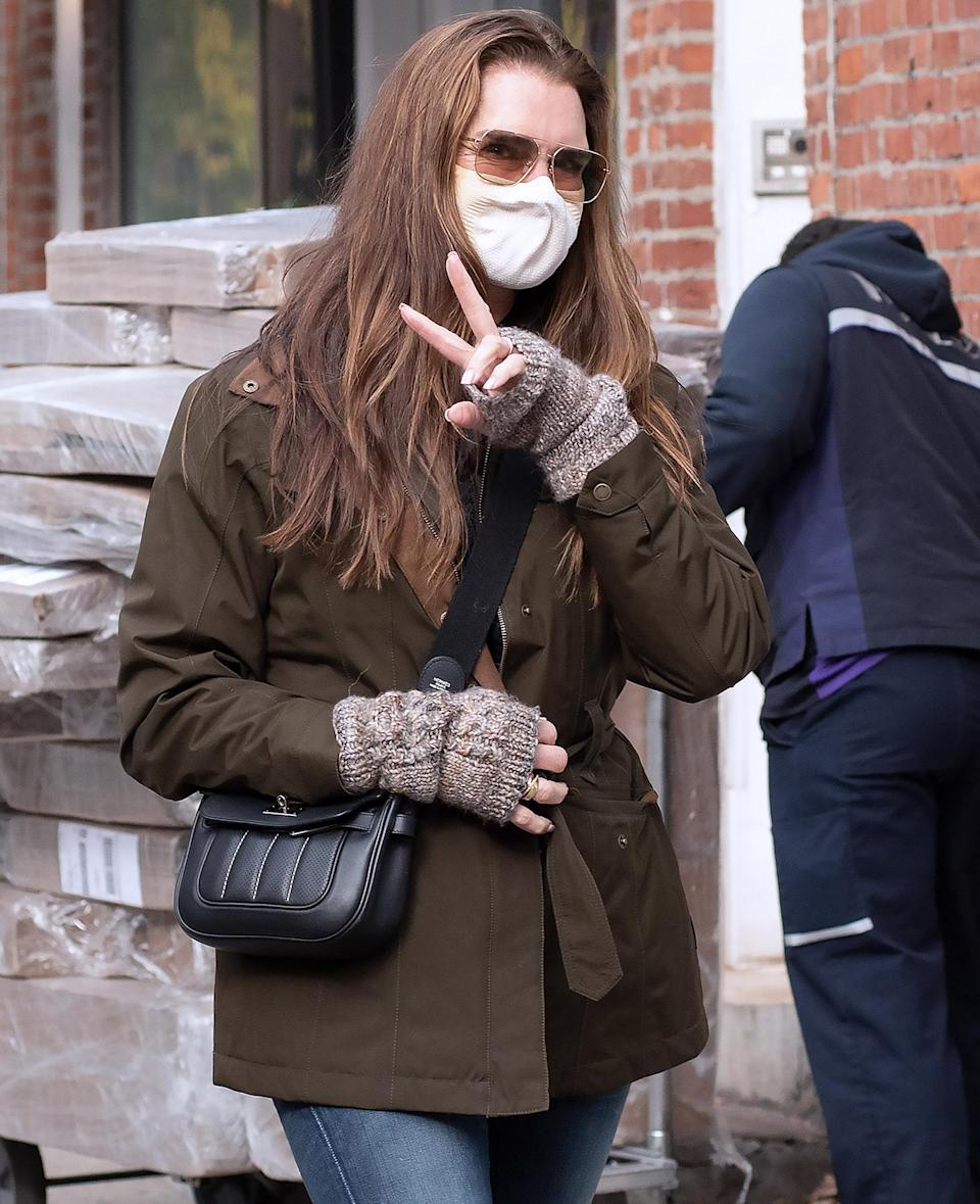 <p>Brooke Shields throws up a peace sign while out in downtown N.Y.C. on Tuesday.</p>
