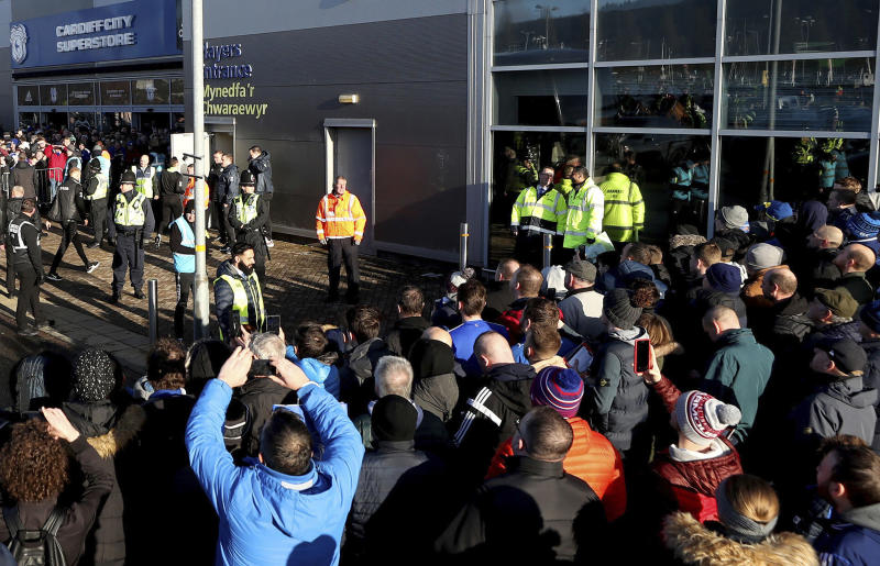 FILE - In this file photo dated Sunday Jan. 12, 2020, soccer fans crowd outside the Cardiff City soccer stadium ahead of the English Championship match against Swansea City, in Cardiff, Wales, as South Wales police are scheduled to test live facial recognition technology to monitor arriving fans for the soccer game.  South Wales police deployed facial recognition surveillance equipment on Sunday Jan. 12, 2020, in a test to monitor crowds arriving for this weekend soccer match in real-time, which is prompting public debate about possible aggressive uses of facial recognition in Western democracies, raising questions about human rights and how the technology may enter people's daily lives in the future. (David Davies/PA via AP)