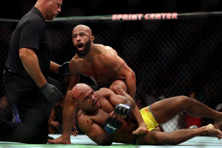 Demetrious Johnson celebrates shortly after submitting Wilson Reis during their UFC fight. (Getty)