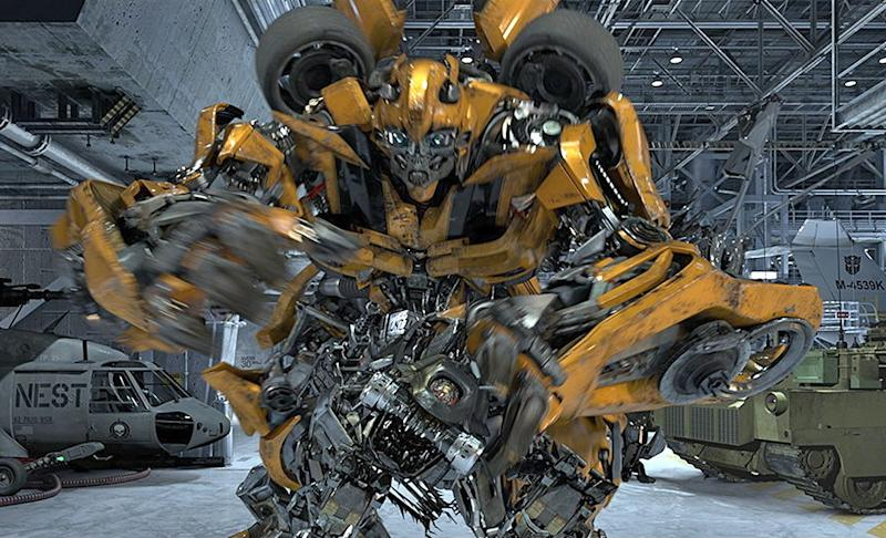 """In this undated image released by Universal Studios Hollywood, the character Bumblebee is displayed from the """"Transformers the Ride: 3D,"""" attraction at Universal Studios Hollywood in Los Angeles. Debuting May 25 at Universal Studios Hollywood, the ride, based on the film franchise, offers motion-simulator vehicles and 3D high definition video. (AP Photo/Universal Studios Hollywood)"""