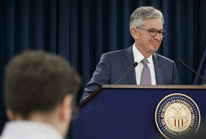 """Federal Reserve Chair Jerome Powell smiles as he finishes speaking during a news conference, Tuesday, March 3, 2020, where he discussed an announcement from the Federal Open Market Committee, in Washington. In a surprise move, the Federal Reserve cut its benchmark interest rate by a sizable half-percentage point in an effort to support the economy in the face of the spreading coronavirus. Chairman Jerome Powell noted that the coronavirus """"poses evolving risks to economic activity."""" (AP Photo/Jacquelyn Martin)"""