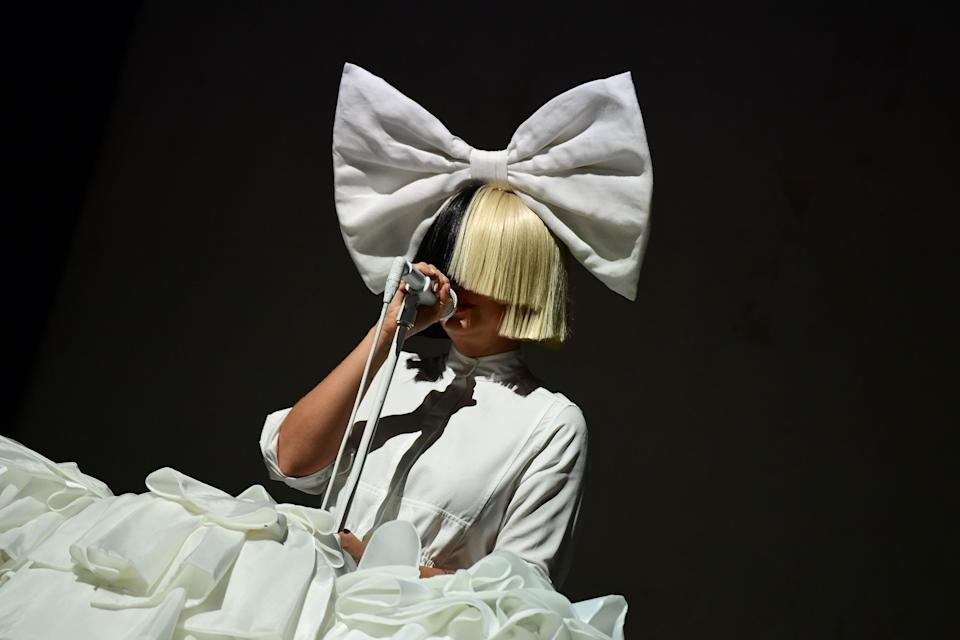 """Australian singer Sia performs on the main stage at the """"Sziget"""" Island Festival in the Hajogyar (Shipyard) Island of Budapest on August 15, 2016. The Sziget music festival is one of the biggest festival of Europe, takes place on an island in the middle of the Danube river, in the heart of Budapest. / AFP / ATTILA KISBENEDEK        (Photo credit should read ATTILA KISBENEDEK/AFP via Getty Images)"""