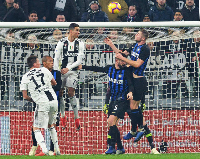 Juventus' Cristiano Ronaldo, 3rd from left, heads the ball during the Serie A soccer match between Juventus and Inter Milan at the Turin Allianz stadium, Italy, Friday, Dec. 7, 2018. (Andrea Di Marco/ANSA via AP)