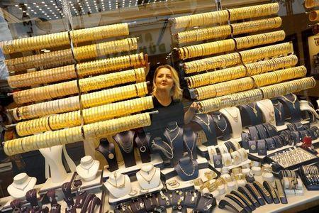 A woman checks products in a gold and jewellery store in the central Anatolian city of Corum