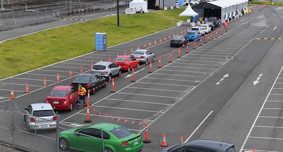 Cars wait in a line at a drive through Covid-19 testing facility in Dandenong, Melbourne. Source: AAP