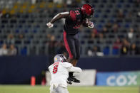 San Diego State running back Greg Bell (22) is tackled by New Mexico cornerback Donte Martin (8) during the first half of an NCAA football game Saturday, Oct. 9, 2021, in Carson, Calif. (AP Photo/Ashley Landis)