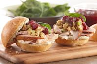 """<p>For a <a href=""""https://www.thedailymeal.com/sandwich-recipes-better-than-mom-made-gallery?referrer=yahoo&category=beauty_food&include_utm=1&utm_medium=referral&utm_source=yahoo&utm_campaign=feed"""" rel=""""nofollow noopener"""" target=""""_blank"""" data-ylk=""""slk:sandwich better than mom ever made"""" class=""""link rapid-noclick-resp"""">sandwich better than mom ever made</a>, stack cold turkey, cranberry sauce, spinach and stuffing on halved dinner rolls. Elevate the easy sammy with homemade sage-infused aioli. </p> <p><a href=""""https://www.thedailymeal.com/best-recipes/ultimate-leftover-turkey-sandwich?referrer=yahoo&category=beauty_food&include_utm=1&utm_medium=referral&utm_source=yahoo&utm_campaign=feed"""" rel=""""nofollow noopener"""" target=""""_blank"""" data-ylk=""""slk:For the Miniature Leftover Turkey Sandwich recipe, click here."""" class=""""link rapid-noclick-resp"""">For the Miniature Leftover Turkey Sandwich recipe, click here.</a></p>"""