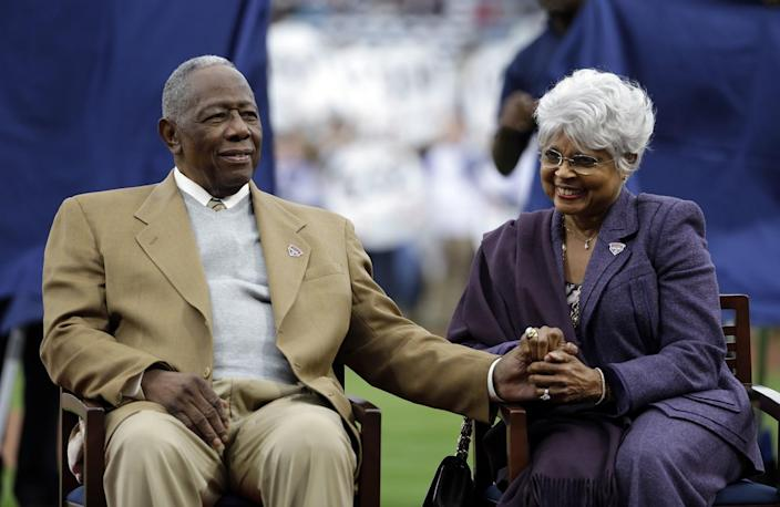 Hank Aaron sits with his wife, Billye, during a 2014 ceremony celebrating the 40th anniversary of his 715th home run.