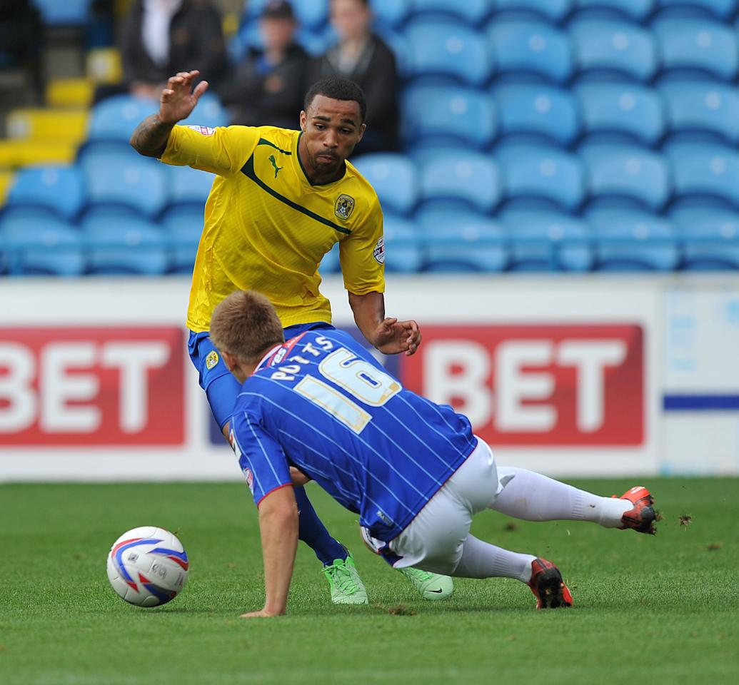 Coventry City's Callum Wilson and Carlisle United's Brad Potts battle for the ball during the Sky Bet Football League One match at Brunton Park, Carlisle.