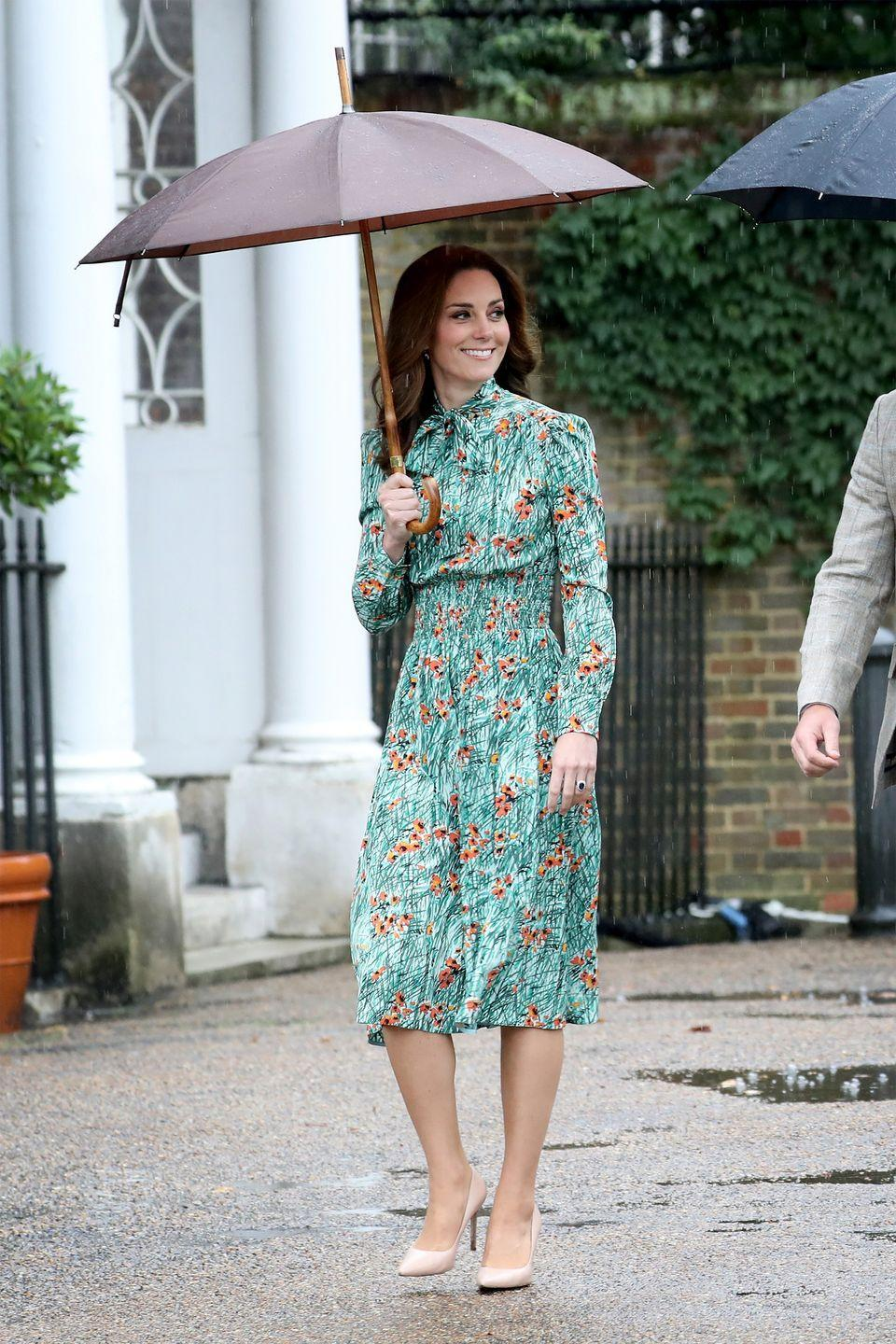 """<p>The Duchess wears a Poppy-print floral pussybow dress by Prada with nude pumps during a rainy visit to the White Garden at Kensington Palace, which is now dedicated to Princess Diana. <a class=""""link rapid-noclick-resp"""" href=""""https://go.redirectingat.com?id=74968X1596630&url=http%3A%2F%2Fwww.matchesfashion.com%2Fus%2Fproducts%2F1154375&sref=https%3A%2F%2Fwww.harpersbazaar.com%2Ffashion%2Ftrends%2Fg1811%2Fkate-middleton-outfits%2F"""" rel=""""nofollow noopener"""" target=""""_blank"""" data-ylk=""""slk:SHOP"""">SHOP</a></p>"""