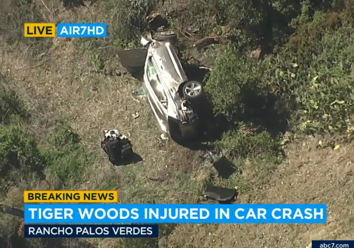 """In this aerial image take from video provided by KABC-TV video, a vehicle rest on its side after a rollover accident involving golfer Tiger Woods along a road in the Rancho Palos Verdes section of Los Angeles on Tuesday, Feb. 23, 2021. Woods had to be extricated from the vehicle with the """"jaws of life"""" tools, the Los Angeles County Sheriff's Department said in a statement. Woods was taken to the hospital with unspecified injuries. The vehicle sustained major damage, the sheriff's department said. (KABC-TV via AP)"""