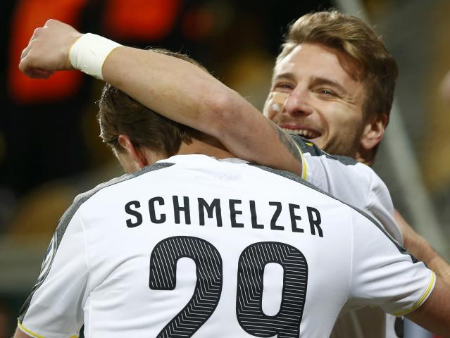 Borussia Dortmund's Italian striker Ciro Immobile celebrates his goal with fellow team mate Marcel Schmelzer against Dynamo Dresden during their German Cup (DFB Pokal) soccer match against in Dresden March 3, 2015. REUTERS/Hannibal Hanschke (GERMANY - Tags: SOCCER SPORT) DFB RULES PROHIBIT USE IN MMS SERVICES VIA HANDHELD DEVICES UNTIL TWO HOURS AFTER A MATCH AND ANY USAGE ON INTERNET OR ONLINE MEDIA SIMULATING VIDEO FOOTAGE DURING THE MATCH.
