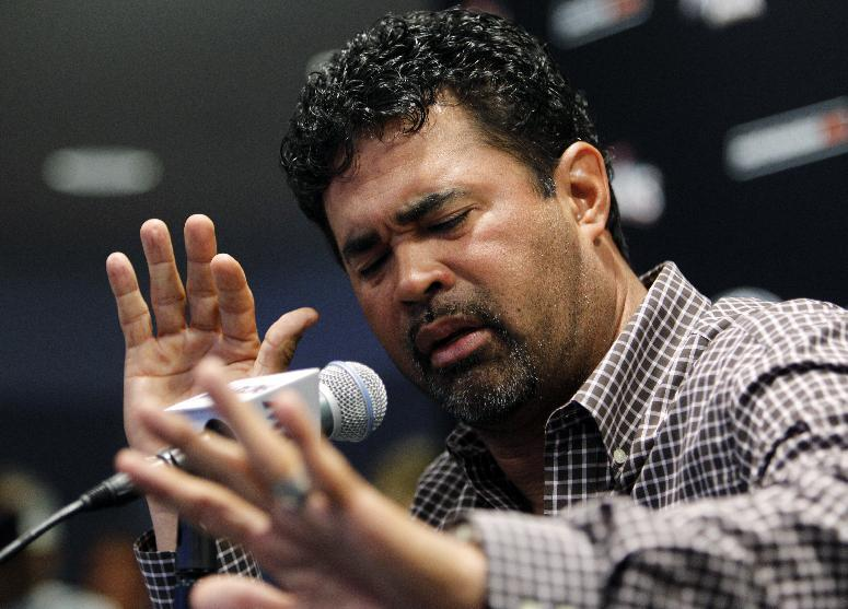 Miami Marlins manager Ozzie Guillen gestures at a news conference at Marlins Stadium in Miami, Tuesday April 10, 2012. Guillen has been suspended for five games because of his comments about Fidel Castro. He has again apologized and says he accepts the punishment.  (AP Photo/Lynne Sladky)