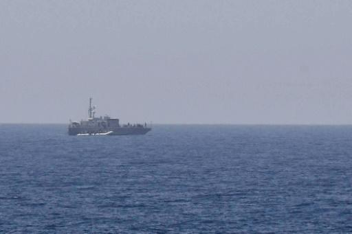A rubber boat with migrants is intercepted by Libyan coast guard, some 24 nautical miles off Libya coast on May 6, 2018