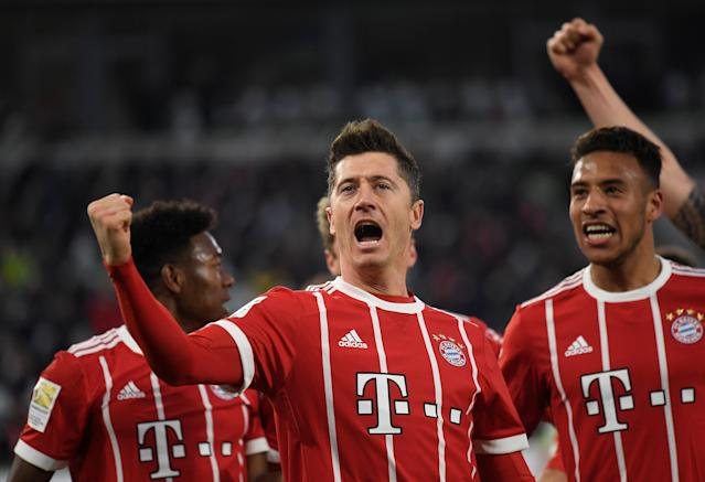 Soccer Football - Bundesliga - VfL Wolfsburg vs Bayern Munich - Volkswagen Arena, Wolfsburg, Germany - February 17, 2018 Bayern Munich's Robert Lewandowski celebrates scoring their second goal with team mates REUTERS/Fabian Bimmer DFL RULES TO LIMIT THE ONLINE USAGE DURING MATCH TIME TO 15 PICTURES PER GAME. IMAGE SEQUENCES TO SIMULATE VIDEO IS NOT ALLOWED AT ANY TIME. FOR FURTHER QUERIES PLEASE CONTACT DFL DIRECTLY AT + 49 69 650050