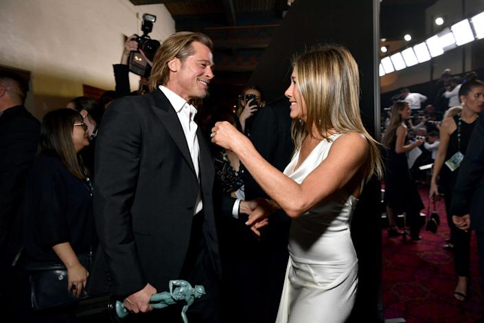 Brad Pitt and Jennifer Aniston backstage at the 26th Annual Screen ActorsGuild Awards. (Photo: Emma McIntyre via Getty Images)