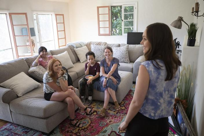 Melissa Anderson, right, discusses decorating ideas with family members.