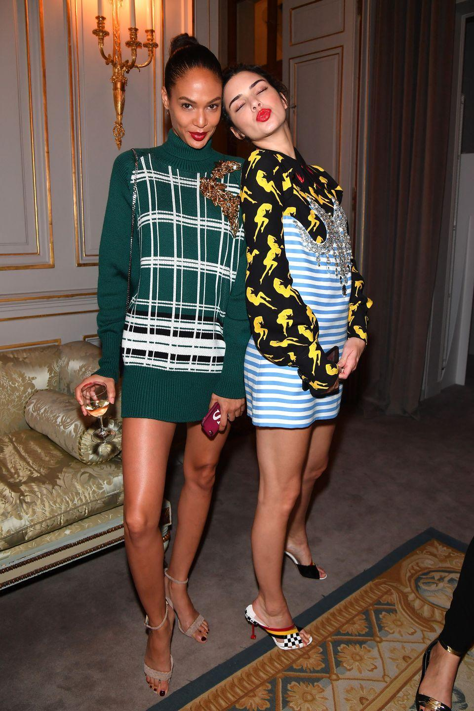 <p>Kendall paired a stripey blue dress with a black and yellow printed shirt at the Miu Miu Cruise Collection Show cocktail party with Joan Smalls</p>