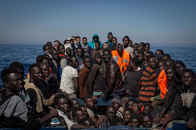 <p>Refugees and migrants wait to be rescued from a small wooden boat by crew members from the Migrant Offshore Aid Station Phoenix vessel on May 18, 2017, off Lampedusa, Italy. (Photo: Chris McGrath/Getty Images) </p>