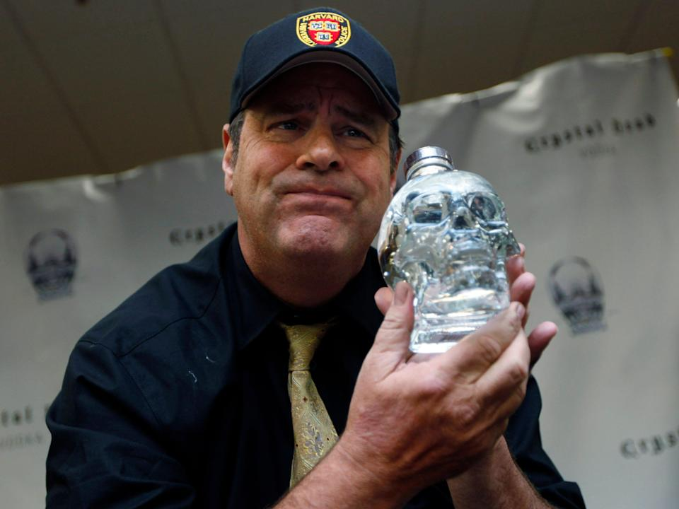 Actor Dan Aykroyd poses for photographs while he promotes his new Crystal Head Vodka