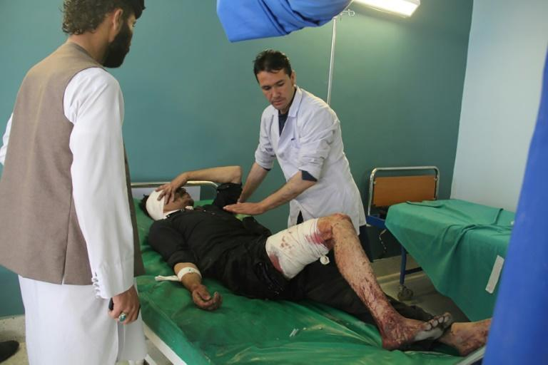 A wounded Afghan man receives treatment at a hospital after a suicide attack in Gardez, capital of Paktia province, on October 17, 2017