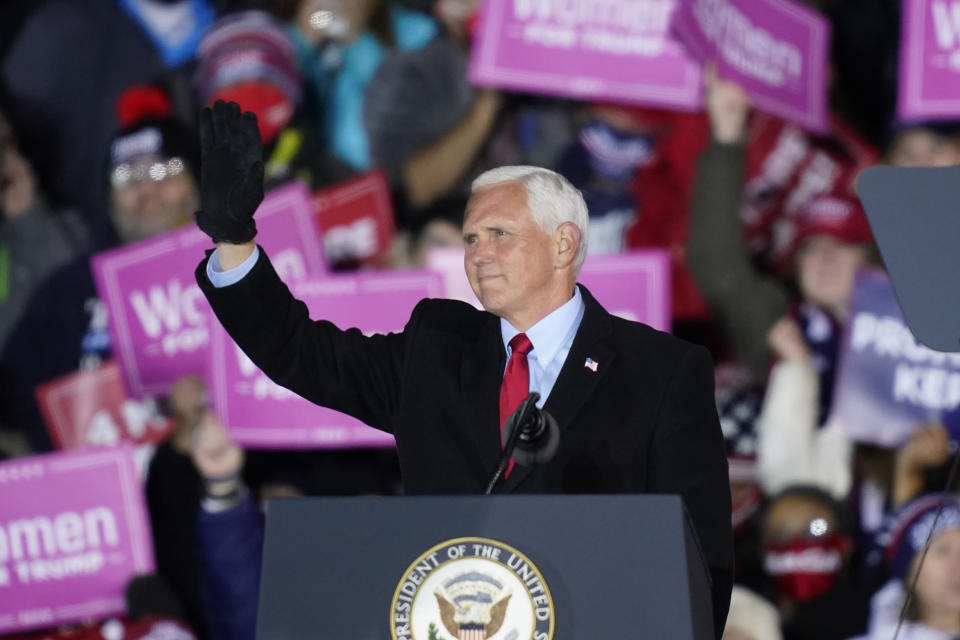 Vice President Mike Pence acknowledges the crowd during a campaign event, Monday, Nov. 2, 2020, in Grand Rapids, Mich. (AP Photo/Carlos Osorio)