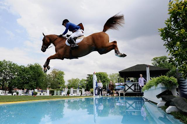 HAMBURG, GERMANY - MAY 19: Gerco Schroeder of Netherlands and Eurocommerce London compete in the CSI5 Global Champions Tour Grand Prix of Hamburg during day three of the German Jumping & Dressage Grand Prix 2012 at Klein Flottbek on May 19, 2012 in Hamburg, Germany. (Photo by Dennis Grombkowski/Bongarts/Getty Images)