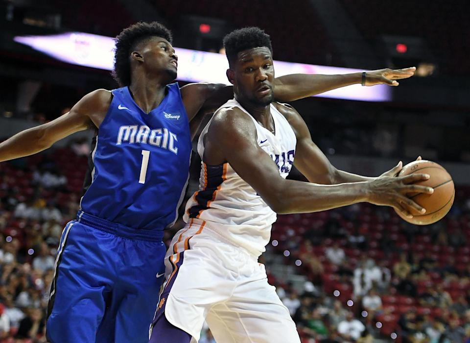 Deandre Ayton is guarded by the Magic's Jonathan Isaac on Monday in Las Vegas. (Getty Images)
