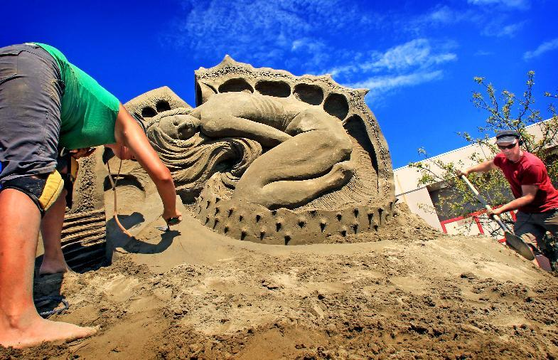 In this Aug. 28, 2011 photo, Susanne Ruesler from the Netherlands, left, and Fergus Mulvany from Dublin, Ireland, put the finishing touches on their sand sculpture called A Beautiful Malady during the final day of doubles competition at the World Championships of Sand Sculpting Tournament of Champions in Federal Way, Wash. The pair had 56 hours to complete their sculpture and were competing for a $3,000 first prize. The event runs until Sept. 5. (AP Photo/The News Tribune, Dean J. Koepfler)